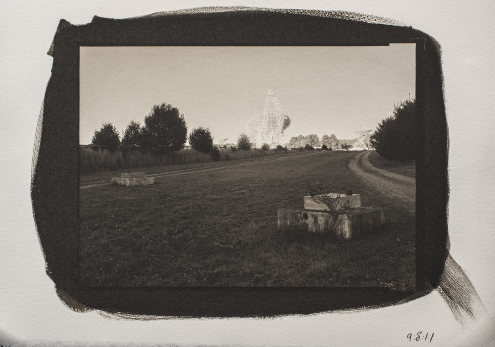 A platinum/palladium print of a sunset shot taken from the interferometry road between the 85-2 and 85-3 telescopes, with the Green Bank Telescope in the Background, at Green Bank National Radio Astronomy Observatory